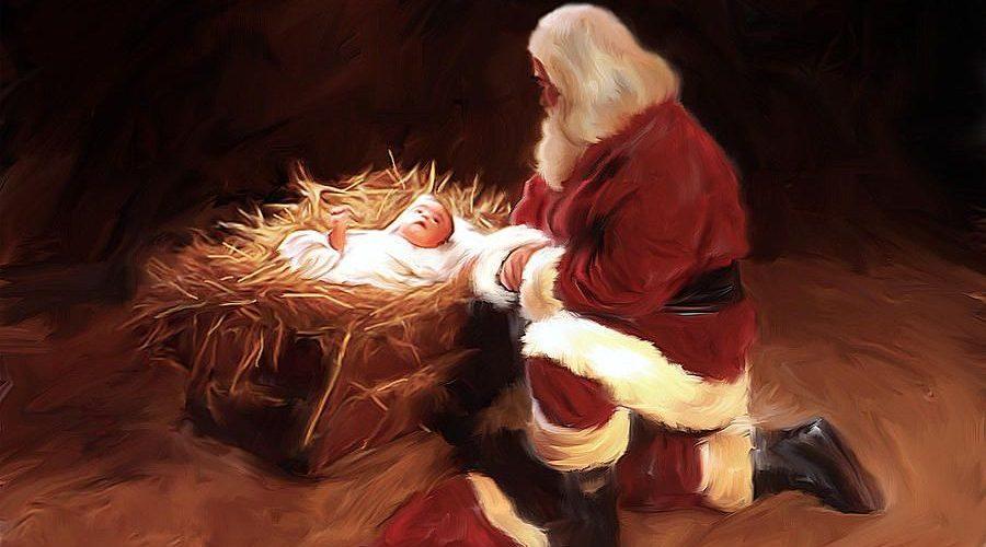 Santa Klaus kneeling before baby Jesus